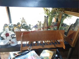 Decor items on 1 shelf  cat statues  frogs  mirror