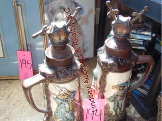 2 urns w  lids  1 has damage  approx 20  tall