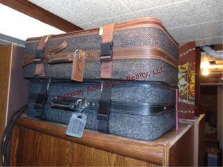 2 Jaguar suitcase sets  brown   black