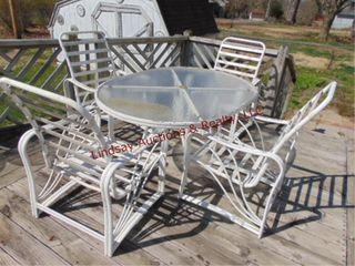 Metal table 41  x 57  w  4 chairs  no cushions