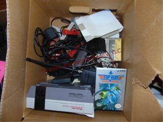 Nintendo game console w  2 controllers  gun