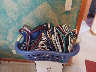 Approximately 80 Hangers in laundry Basket