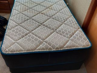 Twin Size Mattress Set   Has a Stain   Includes Hollywood Frame in Garage