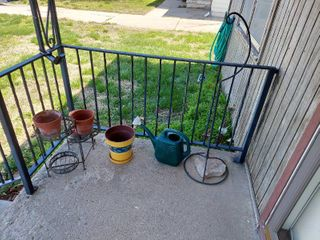 Plant Stand  Planters  Water Can and Metal Stand