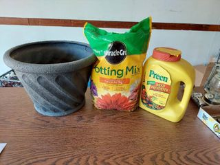 Planter  Potting Mix and Preen  About 1 2 Full