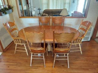 Dinning Table with 24in leaf and 6 Pressed Back Chairs  2 are Captains Chairs
