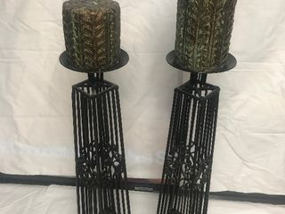 Two decorative candleholders with candles