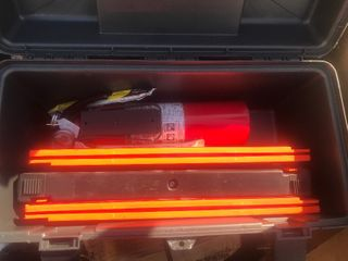 Roadside emergency kit with triangles and fire extinguisher in a toolbox