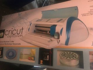 New in box Cricut expression electronic cutter look up on Internet for full description