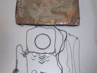Small lot of Miscellaneous Jewelry with Makeup Bag   Flower Bracelet  Evil Eye Necklace  Gold Toned Pin and Other Items