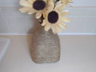 Glass Square Bottle with Twine Wrapped Around and Plastic Sunflowers