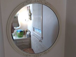 Round Circle Mirror with White Wooden Frame with Intricate Detailing