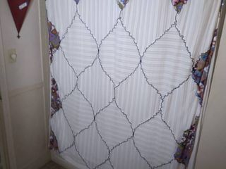Shower Curtain with Shower Rings and White Oval Bath Mat