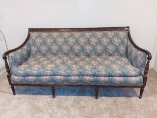 Comfortable Vintage Floral Couch With Wooden Border And Feet
