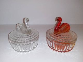 2 Swan Candy Dishes   1 Clear Glass   1 Orange Colored Small Chip In Glass