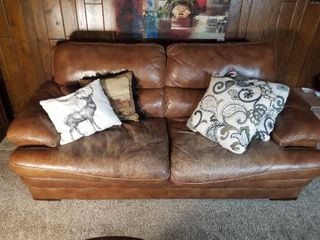 Brown leather Couch  Slight Wear and Tear  Zipper in Right Cushion Broken  Pillows Included