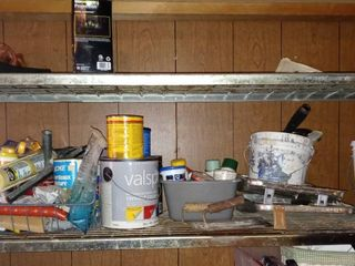 Rack lot Of Paint And Painting Supplies