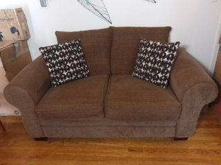 Nebraska Furniture Mart Big Firm and Comfy Brown and Red Patterned love Seat with Matching Throw Pillows