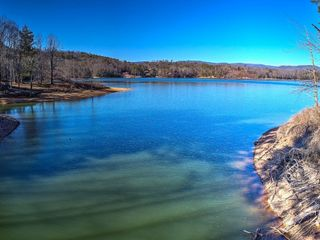 7 + OR - ACRES OF BEAUTIFUL WATAUGA LAKE FRONT PROPERTY
