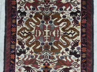 BAlUCHI HAND KNOTTED WOOl ACCENT RUG  3 3  X 5