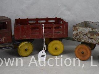 Girard pressed steel stake truck pulling extra wagon