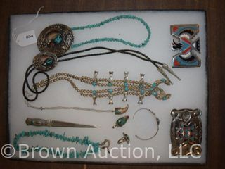Assortment of Native Indian jewelry inc  turquoise necklaces  bracelet  bolo tie  belt buckles  etc