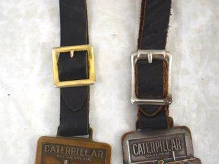 2  Caterpillar watch fobs