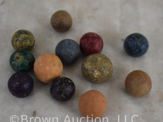 12  Clay marbles