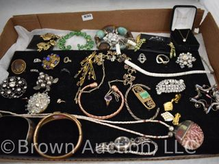 Assortment of jewelry incl  necklaces  bracelets  rings  brooches  etc