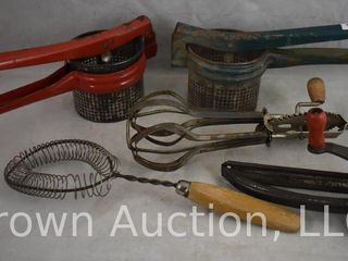 Old kitchen utensils incl  Mouli grater  whisk  beater and hand squeeze juicers