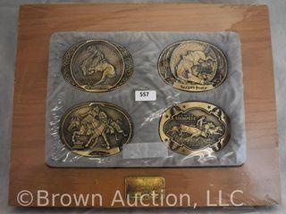 4  Framed belt buckles   Frederic Remington