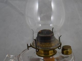 Thumb hold kerosene lamp in decorative gold pedestal base