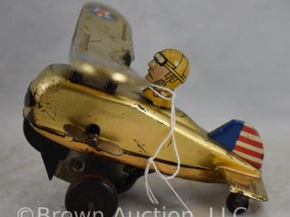Tin wind up looping action Circus plane