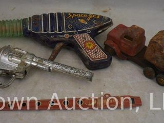 Assorted toys incl  metal flute  Kit Carson cap gun  crane toy truck  as is  Space Jet friction ray