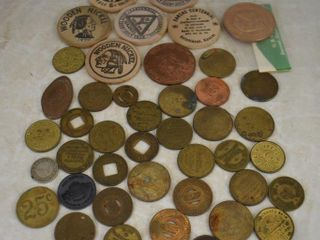 Assortment of souv  wooden nickels and tokens  parking and restroom