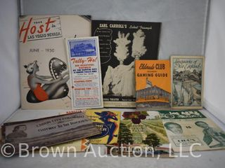 Assortment of travel guides  paper goods and booklets