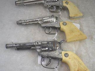 3  Toy cap guns  plastic grips