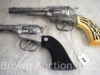 2  Toy cap guns  plastic grips