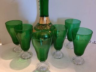 Green glass carafe with glasses