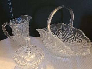 Assorted glass decor Including pitcher  candy dish and bowl with handle