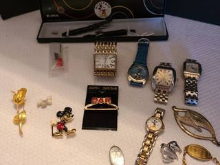 Assorted watches pins and more