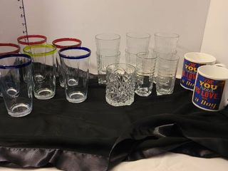 Assorted drinking glasses and coffee mugs