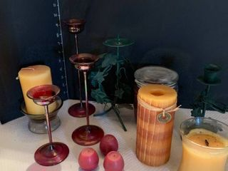 Assorted candle stick holders and candles