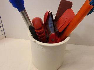 Kitchen utensils in crock that has minor chip