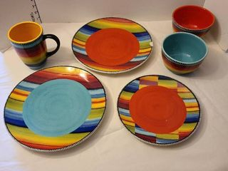 Colorful plates  bowls and mug  One plate has a chip