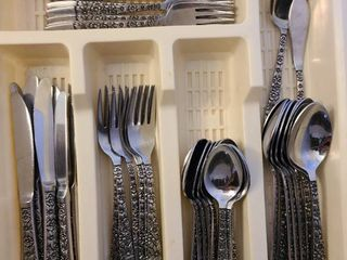 Stainless flatware in tray