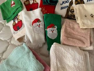Assorted hand towels including some Christmas towels