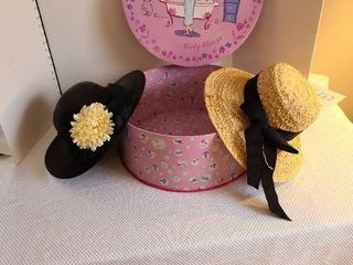 Two ladies hats and hat box