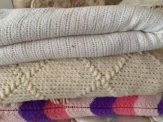 Three throw blankets