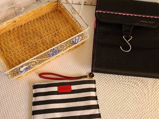 Mary Kay and Sephora make up travel bags and a basket